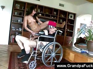 Teen sits on a disabled seniors face