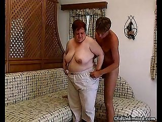 Old fat woman sucking hard in a guy's